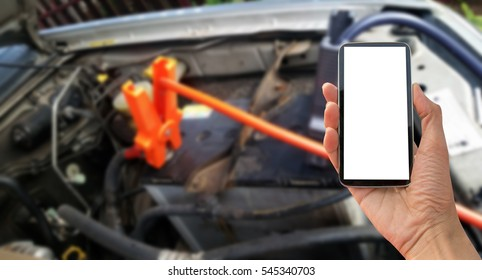 car battery with jumper cable, smart phone