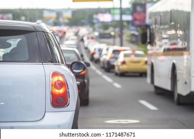 car in a big traffic jam. Back view. Blurred background.