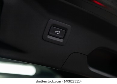 Сlose-up of the car  black interior: trunk release button