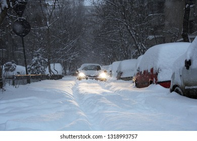 car blocked on a road covered by snow
