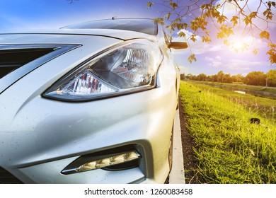 Car Blonde traveling in nature on an asphalt road
