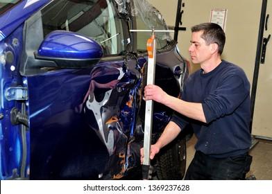 Car body repair in a body shop.