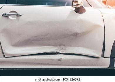 Car body side damage after an road traffic accident,copy space.