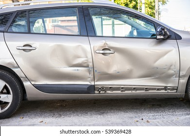 Car body side damage after an road traffic accident.