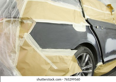 Car body work after the accident by working sanding primer before painting.
