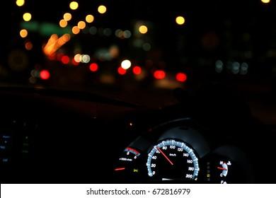 In the car & Bokeh of lighting on the way Bangkok, Thailand
