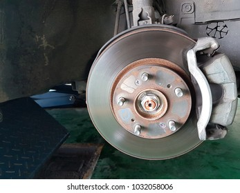 Car brake system diagnosis in a busy garage.