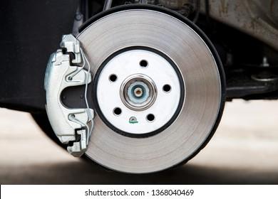 Car brake system. New brake caliper. New brake disk.