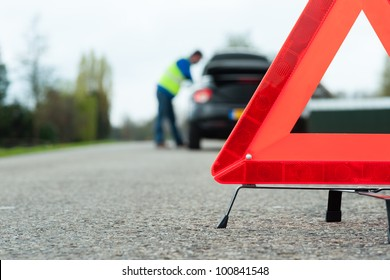 A car with a breakdown alongside the road