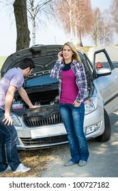 Car breakdown couple calling for road assistance repair motor defect