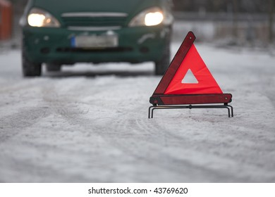car breakdown with warning triangle on the road