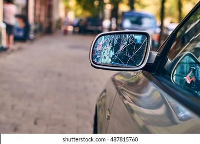 Car with broken side door mirror