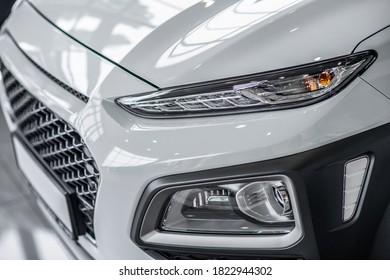 Car bumper. Close up picture of a shiny grey car bumber