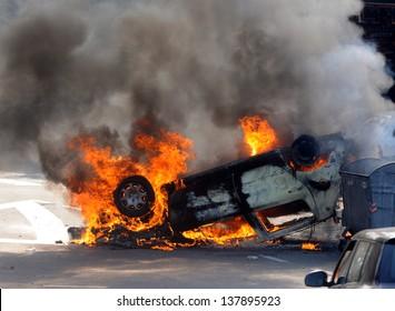 Car burning after street riots