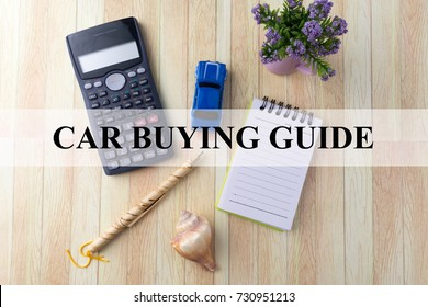 CAR BUYING GUIDE text overlay on background with calculator, toy car, flower decoration, notepad, seashell and pen