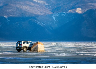 A car and camping on the ice of Lake Baikal  in the winter. Siberia, Russia