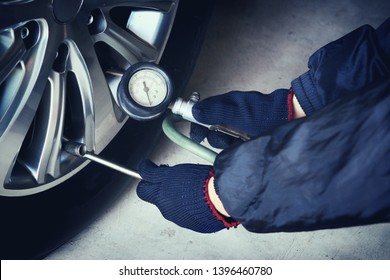 Car care, car mechanic, checking tires and filling tires. (Spot focus)