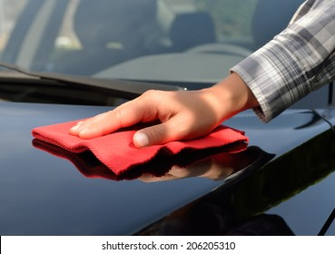 Car care - polishing a black car.
