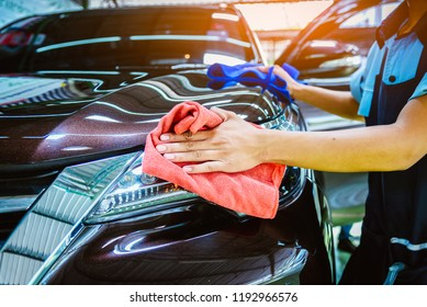 Car care service worker used microfiber cloth cleaning outside car