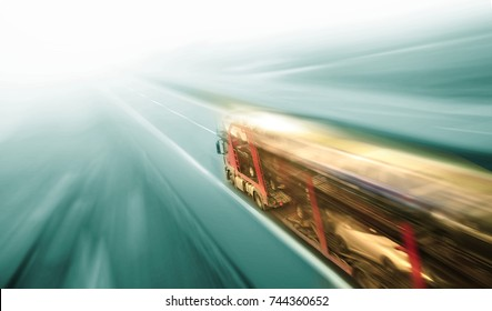Car Carrier on asphalt road motion blur