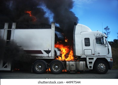 car Carrier on fire and burning up.