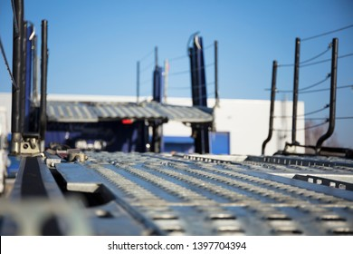 Car carrier transporter truck parked and empty.  Heavy haul trailer