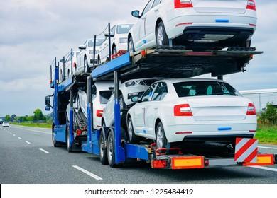 Car carrier truck at the asphalt road of Poland. Truck transporter