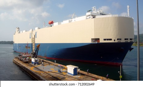 Car carrying vessel about to enter Panama canal. 174m length overall and beam of 32m. Her gross tonnage is 51917 tons.  Can carry 5000 vehicles and was designed to squeeze through the original canal.