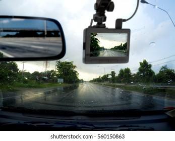 car cemera rain , concept: driving on rainy roads.