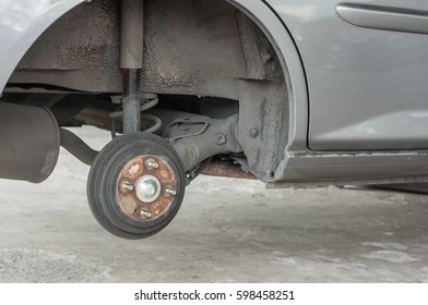 Car changing new tire lift up car by use hand jack.