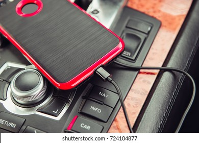 Car charger for the mobile phone. Phone charging in luxury car.