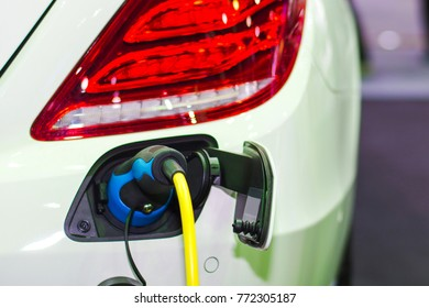 Car charging electric at station