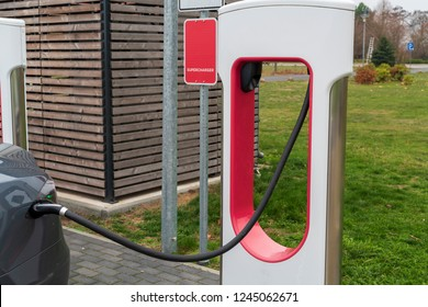 Car at a charging station for E cars