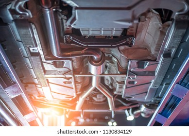 Car chassis bottom view, Automobile mechanic car suspension in service station