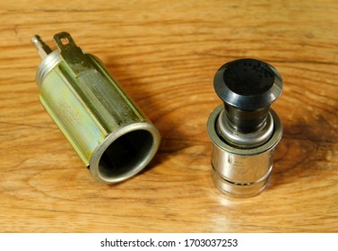car cigarette lighter, on wooden table
