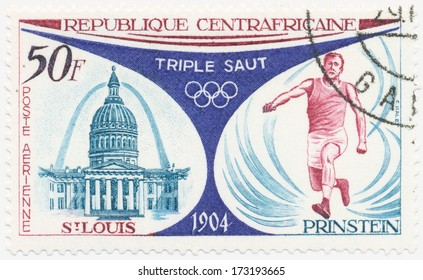CAR - CIRCA 1972: A stamp printed in Central African Republic  shows Old Courthouse and Western Arch, St. Louis, Myer Prinstein, triple jump, 1904, circa 1972