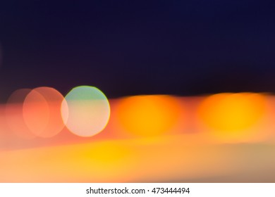 Car and city lights abstract defocused bokeh background; blue, yellow, red and green