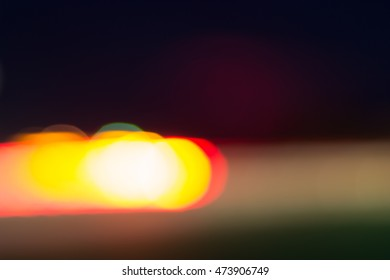 Car and city lights abstract defocused bokeh background. Magenta, yellow, red, green and white colors