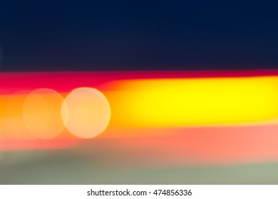 Car and city lights abstract defocused bokeh background. Dark blue, red, yellow, and green colors
