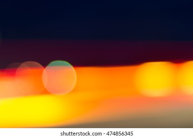Car and city lights abstract defocused bokeh background. Blue, yellow, red, and green colors