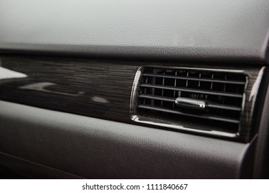 Car conditioner. The air flow inside the car. Detail interior. Air ducts, deflectors on the car panel