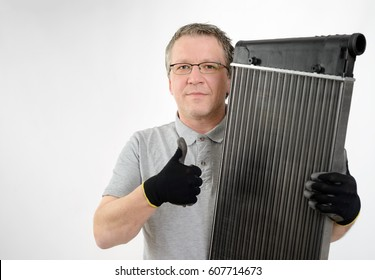 Car cooler, heat exchanger in the hand of the mechanic, workshop, service, repair