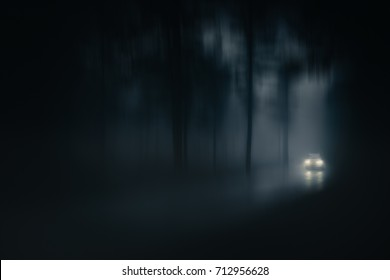 car in a country road with fog and low visibility. Blur added