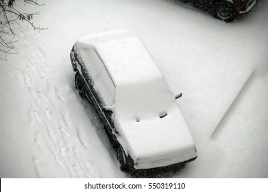 Car covered fresh white snow in winter