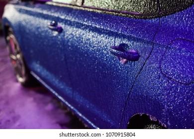 Car covered in ice during freezing rain phenomenon