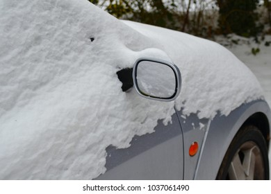 car covered in a layer of snow