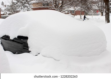 Car covered in snow after storm.  Could be used for tire or snow plow business that could clean your driveway or property