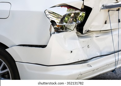 car crash accident, damaged automobiles after collision in city