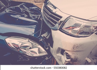 Car crash from car accident on the road in a city between saloon versus pickup wait insurance. , process in vintage style