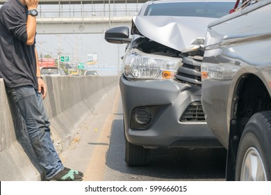 Car crash from car accident on the road in a city wait insurance.